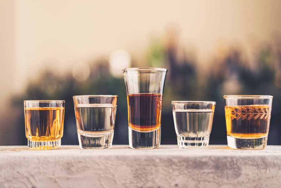 Shot Glasses Filled With Liquor And Spirits