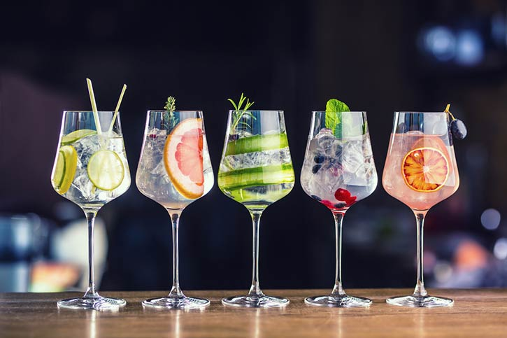 Line Of Cocktails With Fruits.