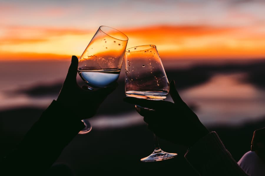 Couple Drinks Wine At Sunset