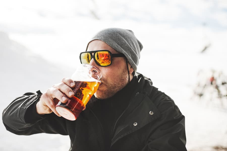 Man With Winter Hat Drinking Outside