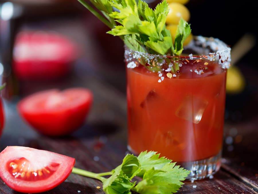 Bloody Mary cocktail with sliced tomato