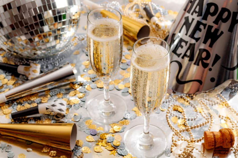 Champagne flutes with New Year's decorations