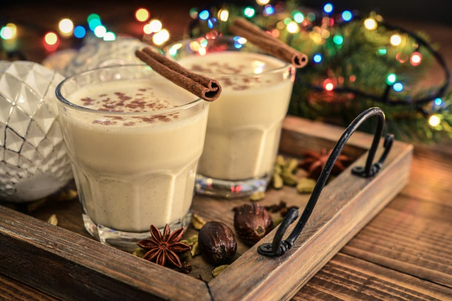 Eggnog on tray with holiday lights in background