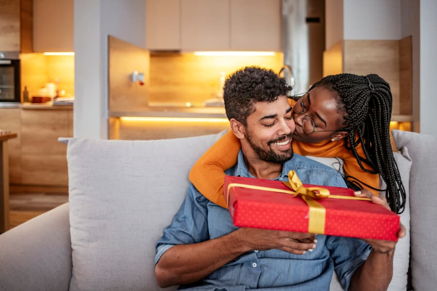 Couple exchanges gift at home